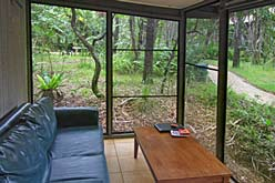 Rainforest holiday cabin screened patio